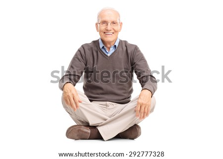 Studio shot of a cheerful senior sitting on the floor and looking at the camera isolated on white background - stock photo