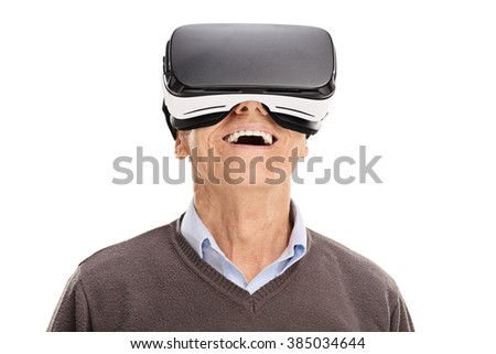 Studio shot of a cheerful senior using a VR headset isolated on white background