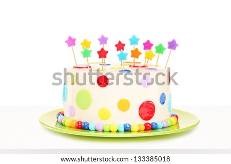 Studio shot of a colorful delicious cake with stars decorations isolated on white background - stock photo