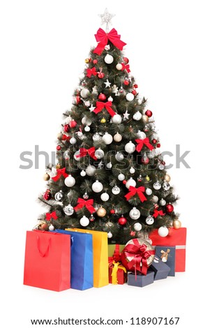 Studio shot of a decorated Christmas tree with gifts and bags isolated on white background