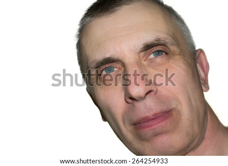 Studio shot of a dreamily looking man with a tilted head, isolated on white
