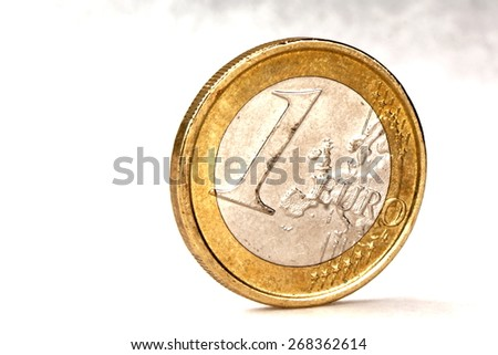 Studio shot of a euro coin on white background