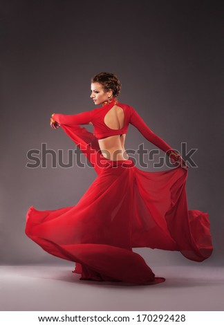 Studio shot of a gorgeous dancer in red clothing