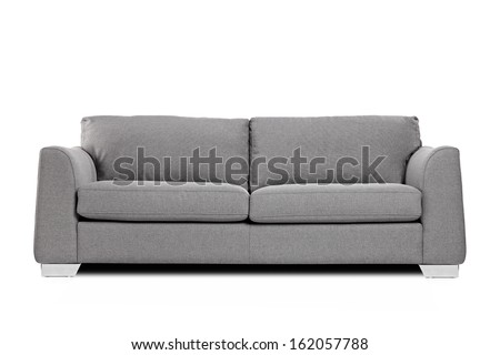Studio shot of a grey modern sofa isolated on white background - stock photo
