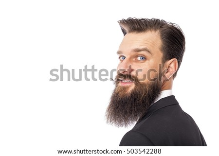 Studio shot of a happy stylish man with beard and mustache