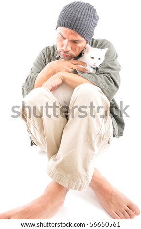 Studio shot of a homeless with his white cat - a series of HOMELESS images. - stock photo