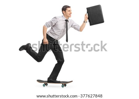 Studio shot of a joyful businessman riding a skateboard and holding a briefcase isolated on white background