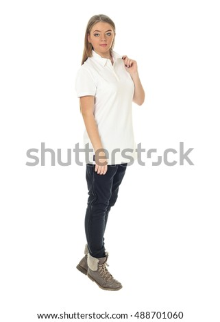 Studio shot of a large woman in blue trousers isolated