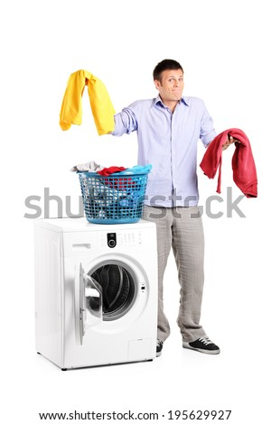 Studio shot of a man wondering how to do the laundry isolated on white background