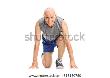 Studio shot of a mature runner in a starting position preparing to run and looking at the camera isolated on white background