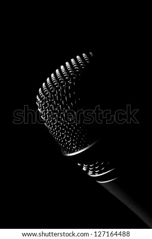Studio shot of a microphone, on black - stock photo