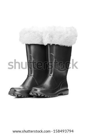 Studio shot of a pair of santa boots isolated against white background - stock photo