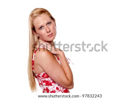 Studio shot of a pretty blonde girl in red print dress on a white background with plenty  of room for copy