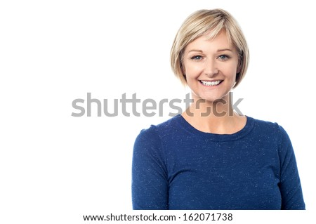 Studio shot of a pretty smiling lady - stock photo