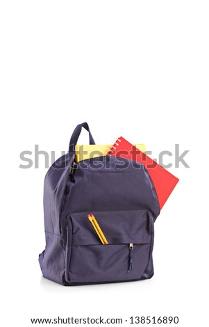 Studio shot of a school backpack with books, isolated on white background - stock photo