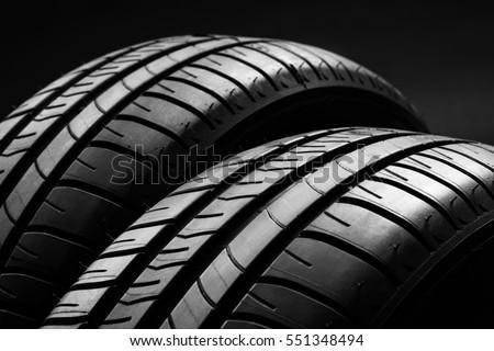 studio shot of a set of summer fuel efficient car tires on black background