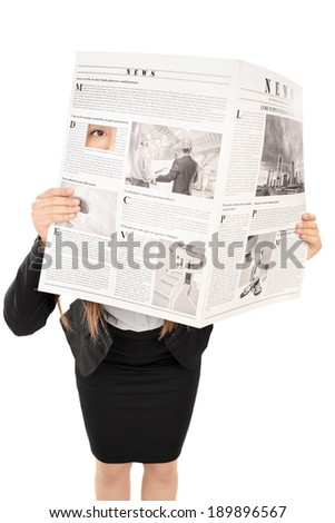 Studio shot of a woman hiding behind a newspaper isolated on white background