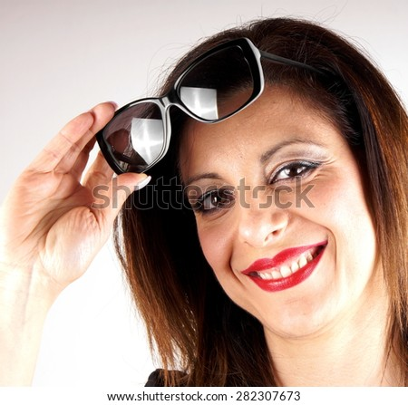 Studio shot of a woman with sunglasses
