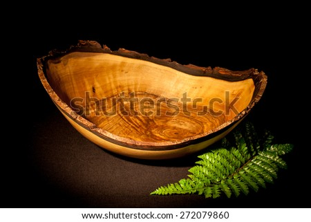 Studio shot of a wooden bowl.