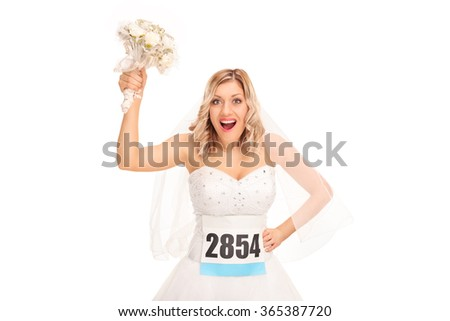 Studio shot of a young bride with a race number holding a wedding flower isolated on white background - stock photo