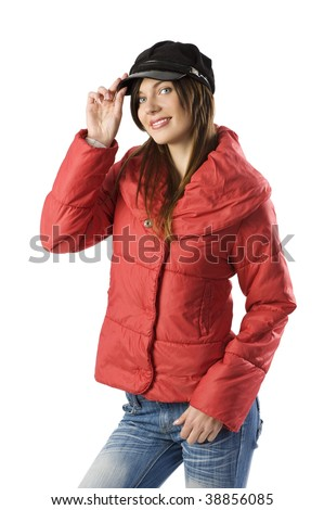 studio shot of a young brunette with a red windbreaker jacket and a nice black cap - stock photo