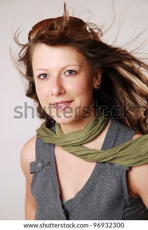studio shot of a young brunette woman