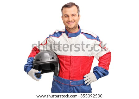 Studio shot of a young car racer holding a gray helmet and looking at the camera isolated on white background - stock photo