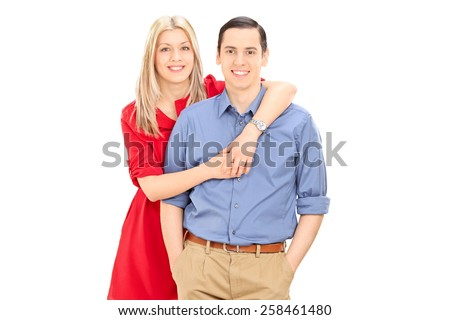 Studio shot of a young couple posing together isolated on white background - stock photo