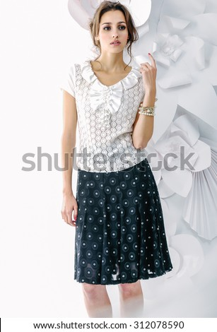 Studio shot of a young fashionable woman on floral background - stock photo