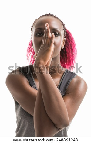 Studio shot of a young fit african woman doing yoga exercises isolated on white background - stock photo