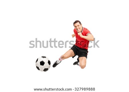 Studio shot of a young football player shooting a football towards the camera isolated on white background - stock photo