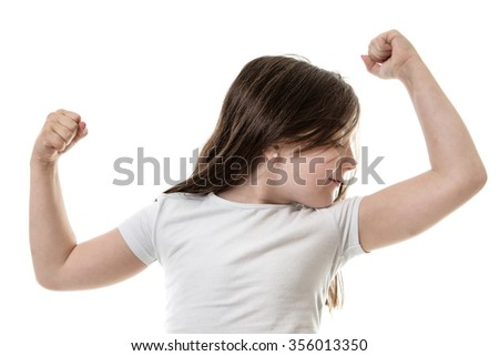Studio shot of a young girl flexing her muscles