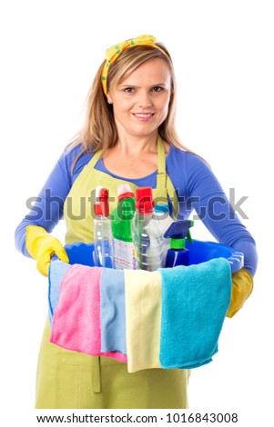 Studio shot of a young housekeeper holding a bowl of cleaning products.