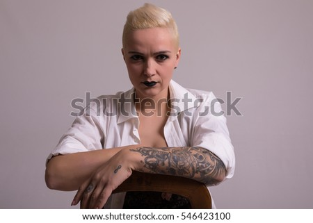 Studio shot of a young tattooed woman