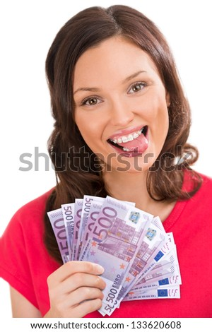 Studio shot of a young woman holding up fanned out banknotes and showing tongue