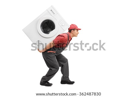 Studio shot of a young worker carrying a washing machine on his back isolated on white background - stock photo