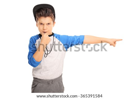 Studio shot of an angry kid in sportswear blowing a whistle and pointing right isolated on white background - stock photo