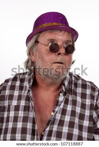 Studio shot of an angry looking elderly man with a cigarette