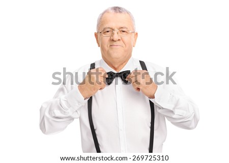 Studio shot of an elegant senior gentleman adjusting his bow-tie isolated on white background  - stock photo