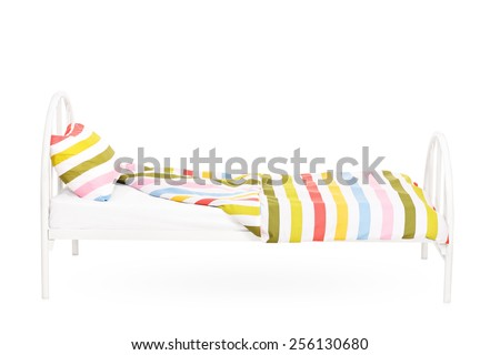 Studio shot of an empty bed isolated on white background - stock photo