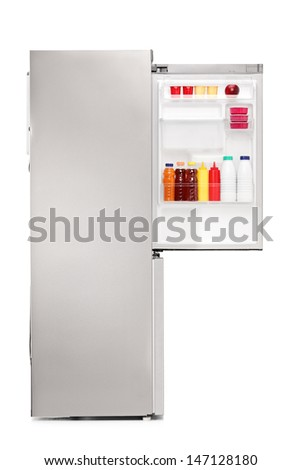 Studio shot of an open fridge full of food products isolated on white background - stock photo