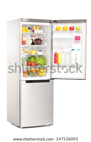 open refrigerator. studio shot of an open fridge full healthy food products isolated against white background refrigerator