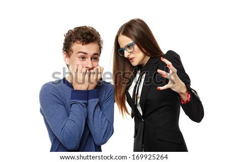 Studio shot of angry menacing teacher teacher threatening student, isolated over white background - stock photo
