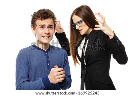 Studio shot of angry menacing teacher threatening student, isolated over white background
