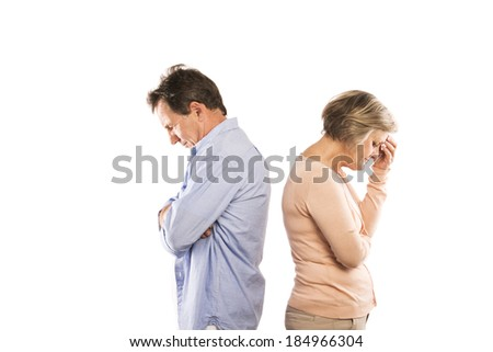 Studio shot of angry senior couple having an argument, isolated on white background. Marriage in crisis. - stock photo