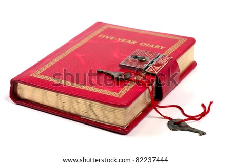 Studio shot of antique diary book with keys isolated on white background - stock photo