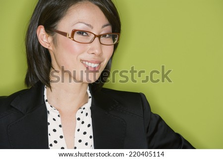 Studio shot of Asian businesswoman wearing eyeglasses - stock photo