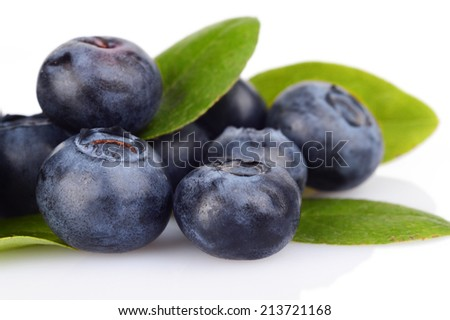 Studio shot of assortment fresh macro close up blueberries with leaves isolated on a white background - stock photo