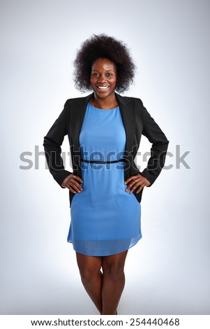 Studio shot of attractive african female model posing confidently on white background