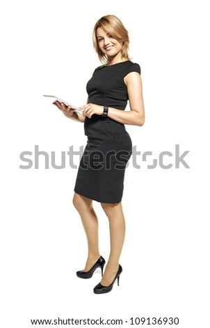 Studio shot of attractive  woman in a black dress. Portrait of office worker isolated on white background. - stock photo